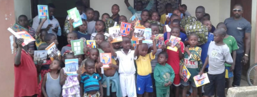 SBA children holding activity books