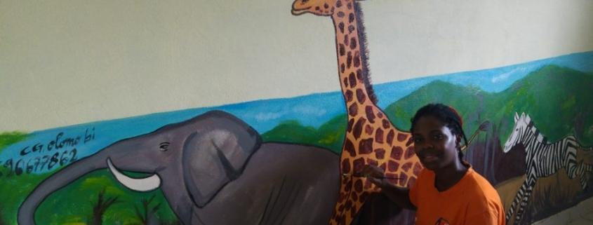Christelle painting her mural