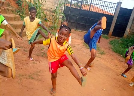 Girl playing rugby in flip flop