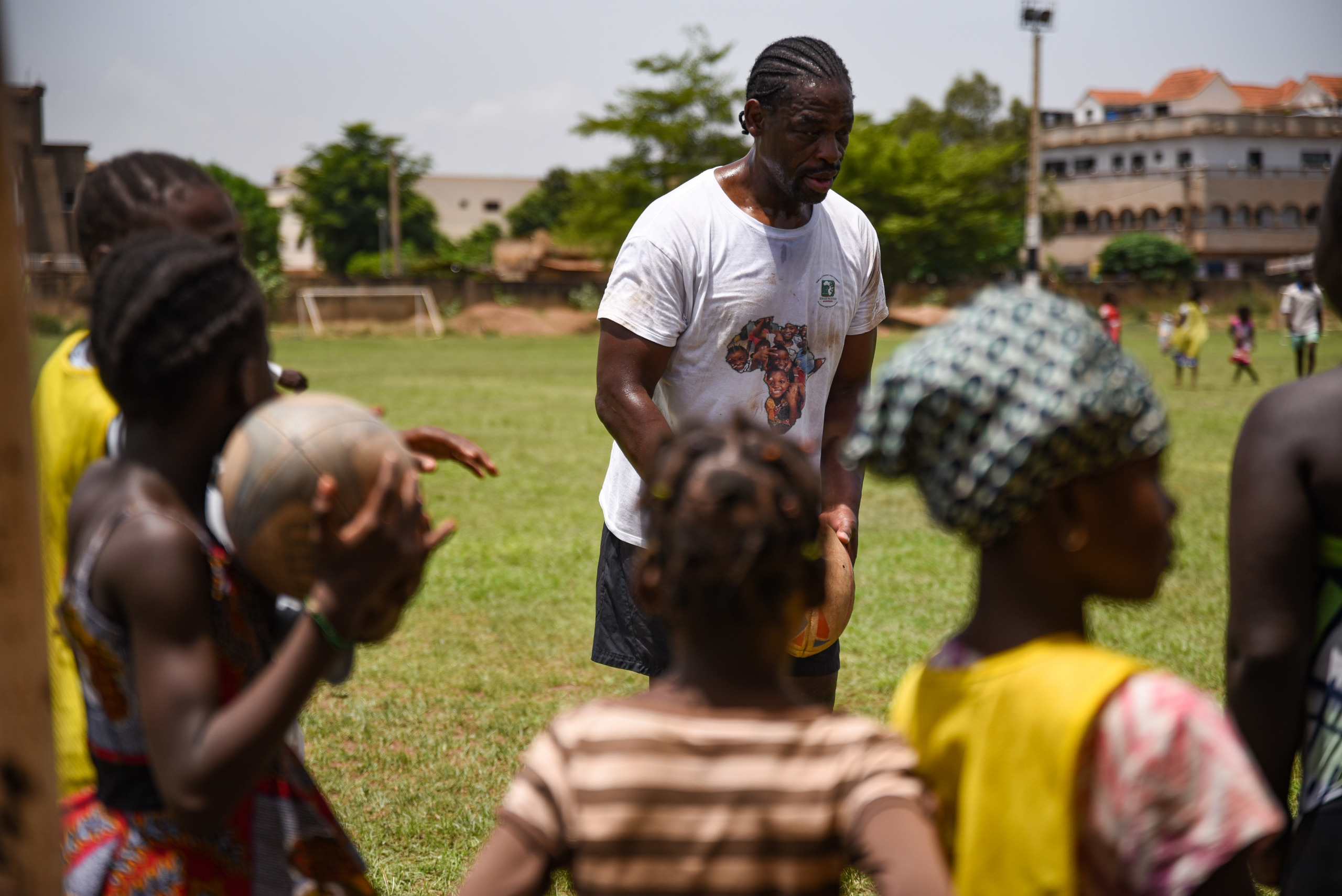 Serge and the girls playing rugby
