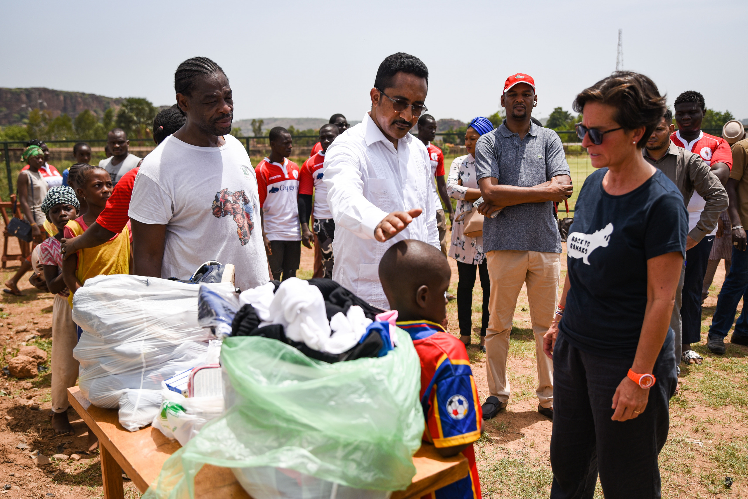 The Minister and a kid receiving trainees