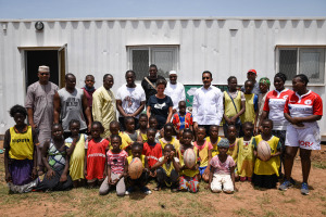 The SBA girls, Mr. Mossa Ag Attacher, Serge Betsen, Odile Prévot in front of the new after-school room