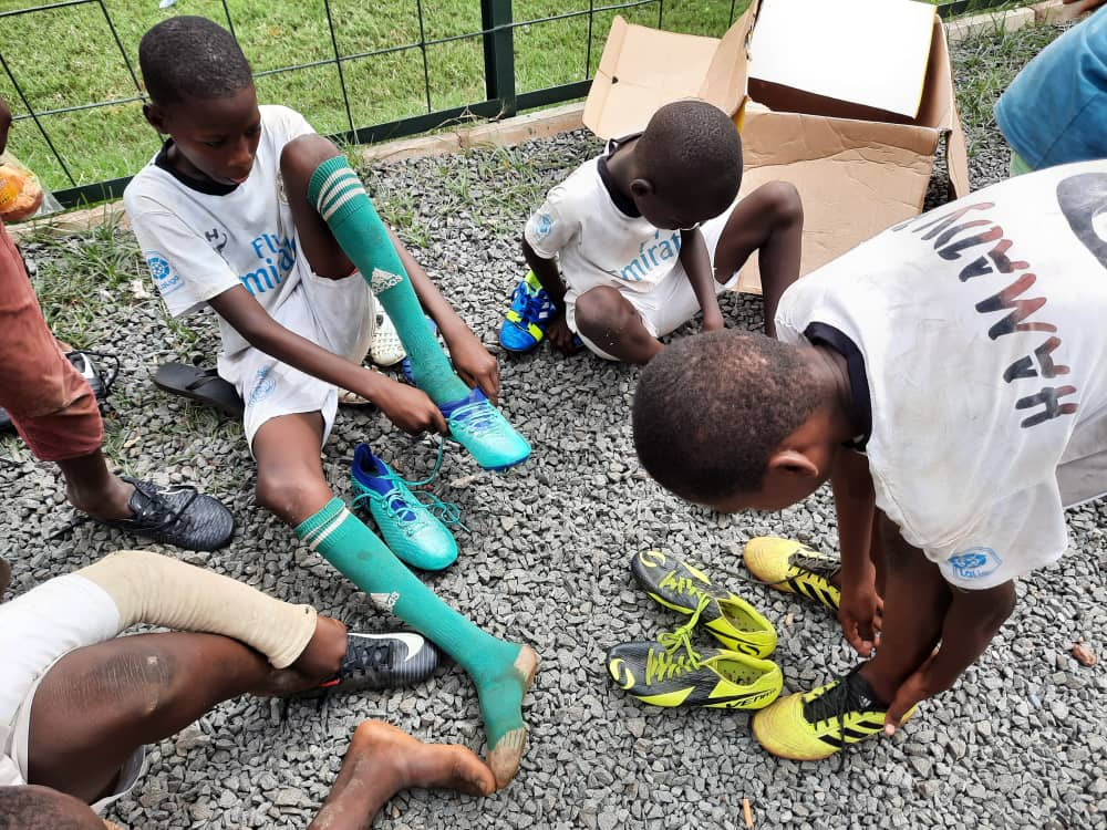Children trying their new rugby boots